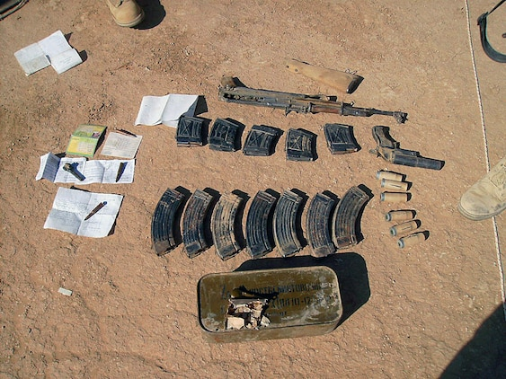 The military police of MP detachment, Combat Logistics Company 19, 1st Marine Logistics Group discovered a small weapons cache in an abandoned town just one kilometer west of Camp Sinjar Nov. 11. The cache consisted of an AK-47, a flare gun, ammunition for the AK and ammunition for a Dragonov sniper rifle. There was no Draganov sniper rifle onsite. The Marines also found numerous papers with Arabic writing, a bag full of syringes, and vials containing an unknown liquid. Marines suspect that the papers may be possible intelligence on the enemy and that the liquid could be some kind of amphetamine, but investigators have yet to make any conclusions. Marines in MP detachment make up one part of the first Marine Air Ground Task Force outside Anbar in Iraq since 2004. They traveled to the Nineweh province to kick off Operation Defeat Al Qaeda in the North II, an operation aimed at stamping out the insurgency just west of the restive city of Mosul.