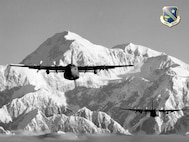 C-130s from the Alaska Air National Guard's 176th Wing fly near Mt. McKinley.