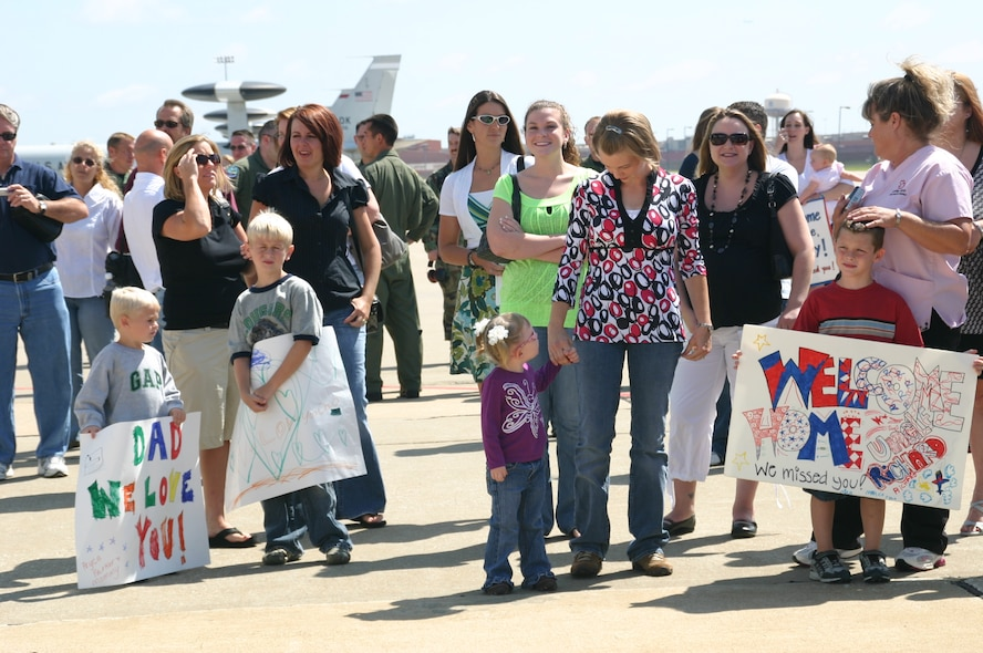 Family and friends of the deployed members of the 960th Expeditionary Airborne Air Control Squadron wait anxiously for their loved ones to arrive back in Oklahoma after their rotation in Southwest Asia, supporting the Global War on Terror. Photo courtesy of 1st Lt. Kinder Blacke.