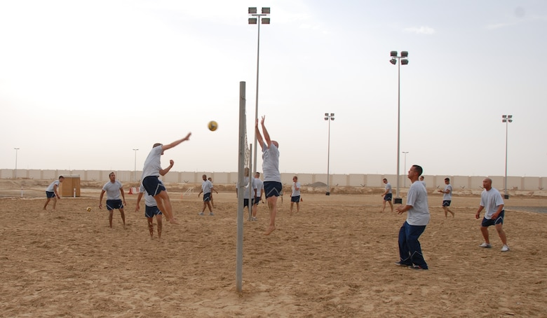 Members of the 960th EAACS relax by playing a little desert volleyball! Photo courtesy of 380 AEW/PA.