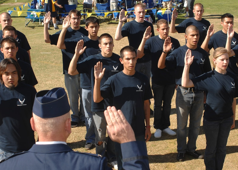 Air Force delayed enlistment recruits are sworn in by Col. Jeffery Robertson prior to the start of the UCLA/Oregon State football game on Nov. 8 at the Rose Bowl in Los Angeles The event was held as part of events leading up to Air Force Week.  Air Force Week serves as the premier platform to share the Air Force story with our fellow citizens. The 2008 Air Force Weeks will include community visits and talks by Air Force officials, flight demonstrations and displays providing an up close and personal look at the men and women of the Air Force serving worldwide in defense of freedom. (Photo by Atiba S. Copeland)
