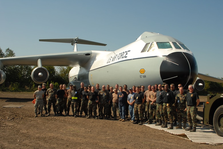 "SCOTT AIR FORCE BASE, Ill. - It took a massive group consisting of members of the 126th Air Refueling Wing, the 375th Airlift Wing, and the 932nd Airlift Wing nearly two days to move  a C-141 Starlifter into its final place of honor in the newly developed Scott Field Heritage Airpark.  The aircraft, tail number 50-236, was a ""Freedom Bird"" aircraft used to transport repatriated POWs and troops back to the U.S. at the end of their tours in Vietnam.  The aircraft initially spent time in the 126 ARW maintenance hangar where it was prepared for permanent static display and then restored to its original colors and paint scheme before being transported on Sept. 9 and 10 to the airpark. (Photographer unknown)"