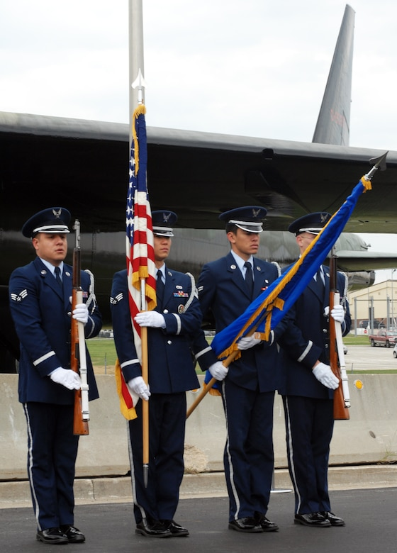 WHITEMAN AIR FORCE BASE, Mo. - Members of the Whiteman Honor Guard prepare to post the colors during the B-52 static display rededication ceremony Nov. 10. the B-52 was repainted and dedicated to Capt. Robert Morris, a B-52 pilot during the Linebacker II missions. Captain Morris and his crew shot down after their mission. (U.S. Air Force photo/Airman 1st Class Carlin Leslie)