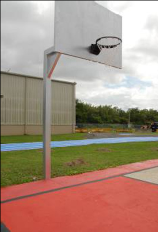 Volunteers repainted the Muniz basketball court. The backboard and basketball rim were given corrosion control treatment and repainted as well.