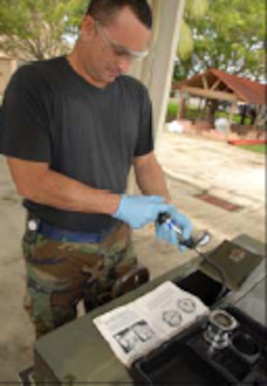 Air National Guard Staff Sergeant Felipe Torres a Powered Support System Journeyman from the Aerospace Ground Equipment shop (AGE), use a Radiator Pressure tester to perform a radiator pressure test to the cooling systems of a A/M 32-86D diesel powered generator. Staff sgt Torres perform this test every six month as part of AGE preventive maintenance program (PMCS). The A/M 32-86D is used to supply electric power to the C130's while are in ground for testing of different systems Air Force photo by: TSgt Tomas Ramirez (released).