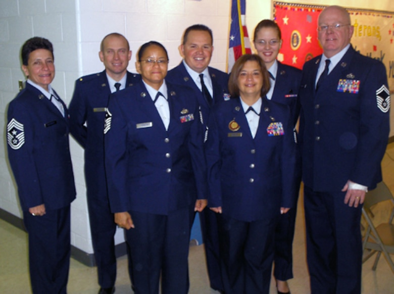 Command Chief Master Sgt. Lisa Kessinger, 2nd Lt. Michael Durbin, Master Sgt. Richard Champ, Airman 1st Class Jessica Donnelly, Senior Master Sgt. John Morrissey, 1st Sgt. Crystal Johnson and Master Sgt. Carol Walsh participated in Operation Patriotism Nov. 11 at Dardenne Elementary School in honor of Verteran's Day.  Operation Patriotism is program that teaches the audience about the history of our Flag and how it came to be what it is today. (Courtesy Photo)