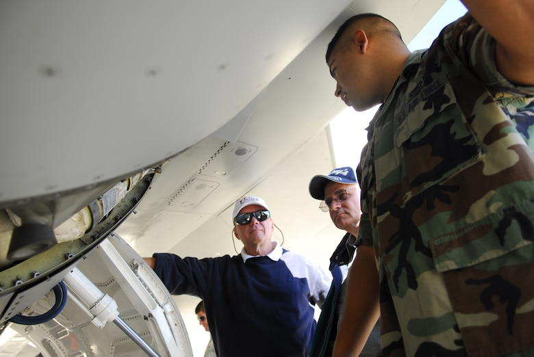 Senior AIrman Rueben Hernandez describes the landing gear of an F-16 during the annual Employer Support of the Guard and Reserve Bosse's Day.  Civilian employers of Texas Air National Guard members got an in depth look at various units during familiarzation tours and climbed aboard a KC-135 to view an aerial refueling mission.  The event was hosted by the 149 Fighter Wing at Lackland AFB, Texas.