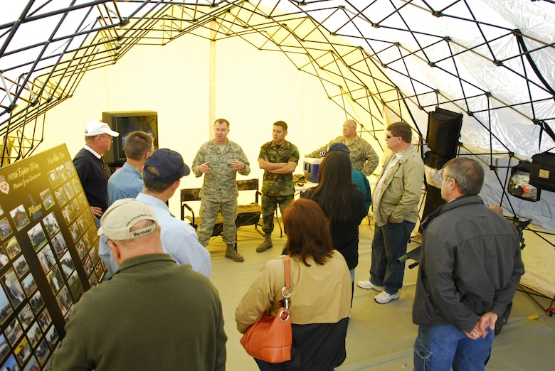 Air Force Capt Harold Hill discusses the capabilities of the Small Portable Aeromeical Rapid Response team during the annual Employer Support of the Guard and Reserve Bosse's Day.  Civilian employers of Texas Air National Guard members got an in depth look at various units during familiarzation tours and climbed aboard a KC-135 to view an aerial refueling mission.  The event was hosted by the 149 Fighter Wing at Lackland AFB, Texas.