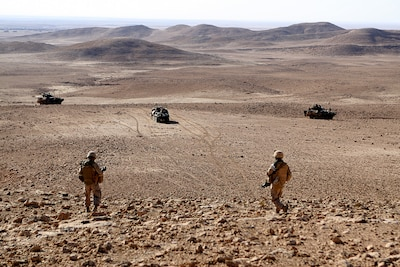 After patrolling through a wadi and searching its caves for evidence of smuggling, scouts from Company C, 1st Light Armored Reconnaissance Battalion move back toward their vehicles to conduct further Reconnaissance in the area west of Mosul. Task Force Ninewa, the ground-combat element for Operation Defeat Al Qaeda in the North II, is built around 1st Light Armored Reconnaissance Battalion (Task Force Highlander). It is comprised of Marines from 1st Tank Battalion, 1st Battalion 2nd Marine Regiment, as well as augments from ANGLICO, Explosive Ordinance Disposal, and other combat assets of the 1st Marine Expeditionary Force, and now controls the open areas of northern Iraq near Mosul.
