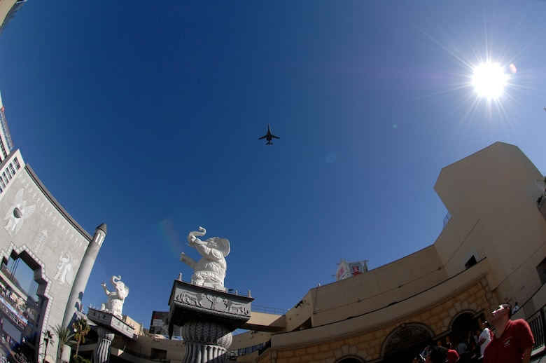 A B-1 Lancer flies over the Hollywood & Highland Center to kickoff Air Force Week in Los Angeles, Nov. 14. (Photo by Joe Juarez)