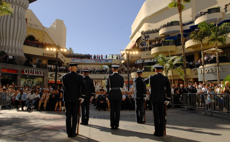 The Air Force Honor Guard Drill Team performs Nov. 14 at Hollywood and Highland in Los Angeles for the opening ceremonies for Air Force Week-Los Angeles. The drill team performance was one of many attractions at the event. Others included flyovers by several different Air Force aircraft, interactive expos and performances by the Air Force band.  Air Force Week-Los Angeles is Nov. 14 to 21 and has events throughout the area.  (U.S. Air Force photo/Senior Airman Tim Chacon)