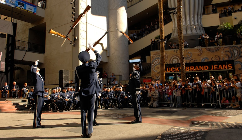 The United States Air Force Honor Guard Drill Team performs Nov. 14 at Hollywood, Calif. and Highland in Los Angeles for the opening ceremonies for Air Force Week in Los Angeles. The Drill Team performance was one of many attractions at the event. Other events included flyovers from several different Air Force aircraft, interactive expositions and performances by the Air Force Band. The event was hosted by Gen. Robert Kehler, Air Force Space Command commander. Air Force Week in Los Angeles is Nov. 14-21. For more information, call (866) 751 8723 or visit www.AirForceWeek.com. (U.S. Air Force photo by Senior Airman Tim Chacon)