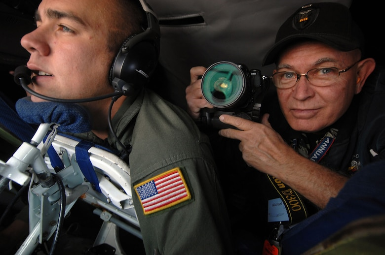 Photographer Mike Mullen, from the San Gabriel Valley Newspaper Group, right, photographs an aerial refueling and Senior Airman Terry Mossbarger, a boom operator from the 336th Air Refueling Squadron, aboard a KC-135R Stratotanker out of March Air Reserve Base during a Media Flight for Los Angeles Air Force Week. (Photo by Master Sgt Rick Sforza)