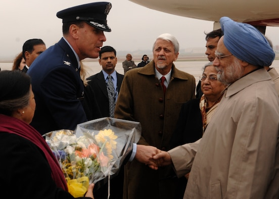 Colonel Steven M. Shepro, 316th Wing commander, greets Indian Prime Minister Manmohan Singh at Andrews Air Force Base, Md., Nov. 14, 2008, for the two-day G20 Summit at the White House in Washington. The summit, hosted by U.S. President George W. Bush, will bring together world leaders to discuss the increasing global financial crisis, its causes and efforts to resolve it. (U.S. Air Force photo by Tech. Sgt. Craig Clapper)