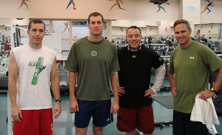 2nd Lt. Mark Fraser, of the 71st Operations Support Squadron,  Maj. Todd Dyer of the 3rd Fighter Training Squadron, Capt. Todd Swanhart of the 33rd Flying Training Squadron and Col. Chris Nowland, 71st Flying Training Wing commander, strike a pose before attacking their morning workout. (U.S. Air Force photo by 2nd Lt. Agneta Murnan)