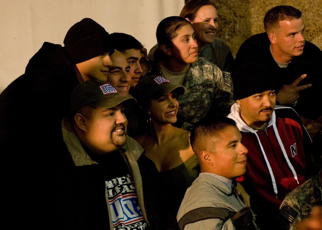 """Celebrities with USO Tour """"Around the World in 8 Days,"""" pose for a photo op with troops after their show at Bagram Air Field, Afghanistan, Nov. 13. (U.S. Air Force photo by Staff Sgt. Samuel Morse)(Released)"""