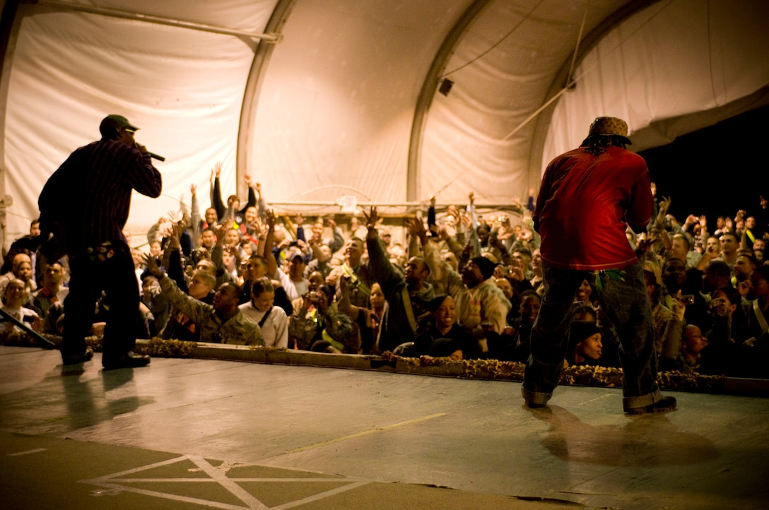 """Kaine and D-Roc of rap group """"Yin Yang Twins"""" performs with USO Tour """"Around the World in 8 Days"""" at Bagram Air Field, Afghanistan, Nov. 13. (U.S. Air Force photo by Staff Sgt. Samuel Morse)(Released)"""