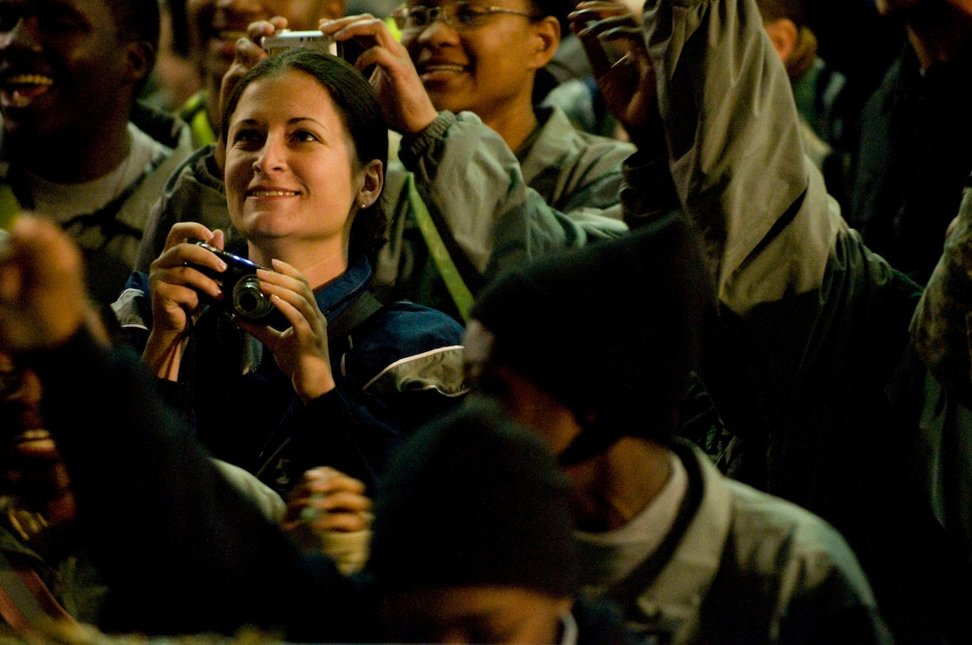 """Airmen and Soldiers cheer and take photos during USO Tour """"Around the World in 8 Days"""" at Bagram Air Field, Afghanistan, Nov. 13. (U.S. Air Force photo by Staff Sgt. Samuel Morse)(Released)"""