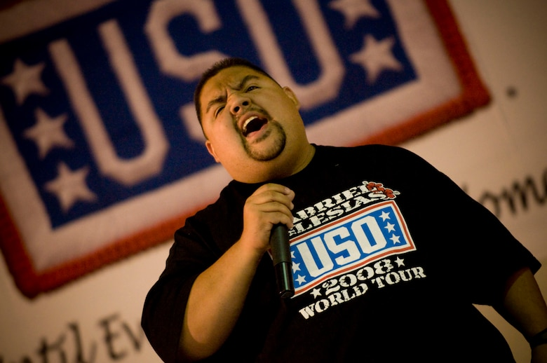 "Gabriel Iglesias, comedian with USO Tour ""Around the World in 8 Days,"" screams while he recounts his ""combat landing"" into Bagram Air Field, Afghanistan, Nov. 13. (U.S. Air Force photo by Staff Sgt. Samuel Morse)(Released)"