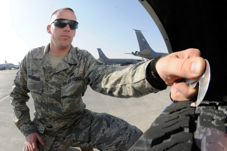Tech. Sgt. Mark Weisbrod, foreign object damage prevention program monitor assigned to the 379th Expeditionary Maintenance Group, removes a rock from his tire using a FOD picker as part of his rollover foreign object debris check before driving onto the flight line Nov. 10, 2008, at an undisclosed location in Southwest Asia. FOD accounts for millions of dollars in damages to aircraft every year. Sergeant Weisbrod, a native of Verona, N.Y., is deployed from Dover Air Force Base, Del. (U.S. Air Force photo by Staff Sgt. Darnell T. Cannady)