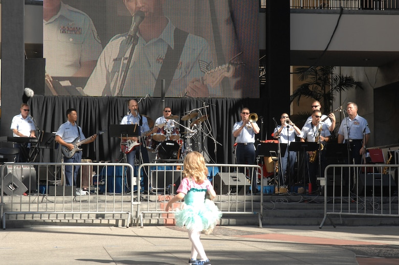 A young girl dances to the beat of the Air National Guard's Band of the Southwest at the Air Force Expo, Nov. 15. The Expo is one of many activities planned in Southern California during Air Force Week, Nov. 14-21. (Photo by SSgt Gallardo)