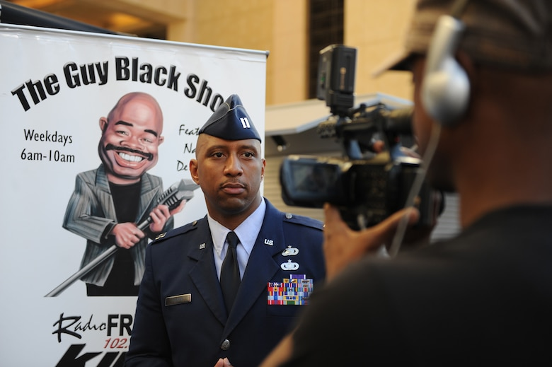 """Capt. Grady Tucker does an interview on, """"The Guy Black Show,"""" during the Air Force Expo at Hollywood and Highland Boulevard in Los Angeles on Nov. 14. Air Force Week Los Angeles runs until Nov. 21 and has events throughout the area. Captain Tucker is the commander of the military personnel element at Los Angeles Air Force Base, Calif. """"The Guy Black Show"""" runs on a local Los Angeles radio station. (U.S. Air Force photo/Staff Sgt. Desiree N. Palacios)"""