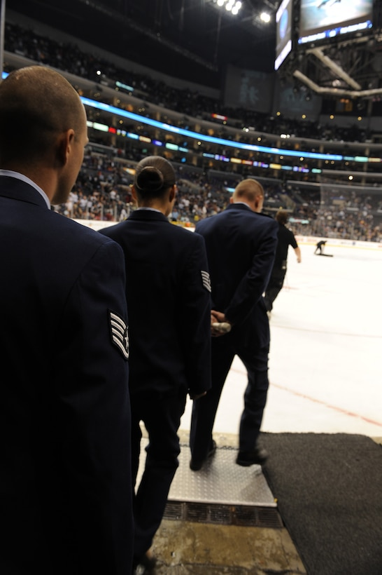 Col. John Odey leads Tech. Sgt. Surita Rorie and Staff Sgt. Robert Coddington onto the ice of the Staples Center, Los Angeles, Calif., Nov. 15. Sergeants Rorie and Coddington reenlisted during a Los Angeles Kings vs. Nashville Predator game as part of Air Force Week Los Angeles. Colonel Odey is the 95th Communications Group Commander, Edwards Air Force Base, Calif. Sergeants Rorie and Coddington are stationed at Edwards Air Force Base, Calif. Air Force Week Los Angeles is an event designed to educate the local population about the Air Force's capabilities and missions through various activities and exhibitions all over the Los Angeles area. It provides an up close and personal look at the men and women of the Air Force serving worldwide in the defense of freedom. Air Force Week Los Angeles runs from Nov. 14 to 21.  (U.S. Air Force photo/Staff Sgt. Desiree N. Palacios)