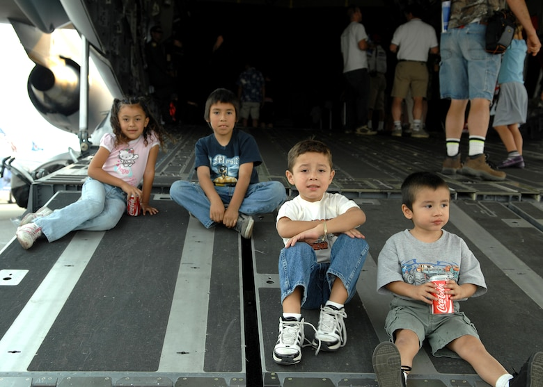 The Pineda Children from Baldwin Park California sit on the tail ramp of a C17 Globemaster III during Wings Over Long Beach at the Long Beach Airport, November 15, 2008.  (U.S. Air Force photo by Senior Airman Matthew Smith)
