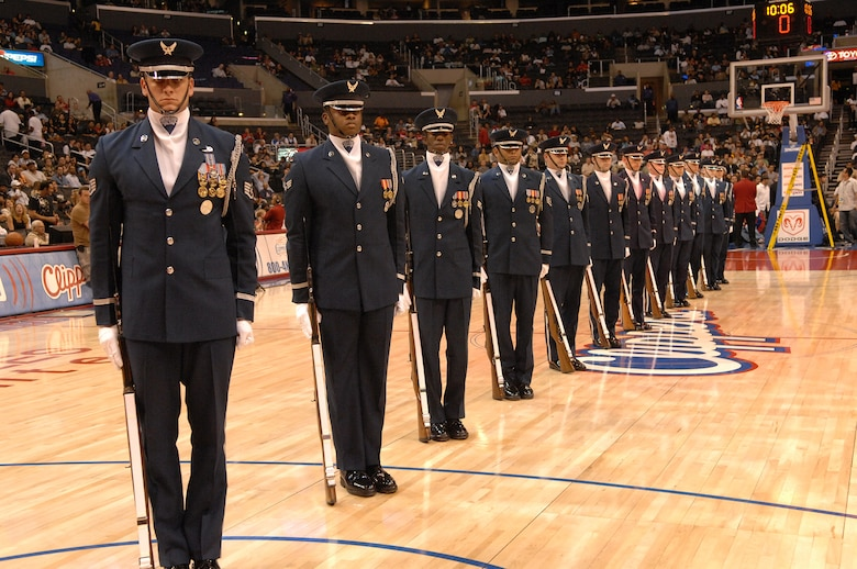 The U.S. Air Force Honor Guard Drill Team performs at the Staples Center in Los Angeles California before the Clippers vs. Spurs basketball game during Air Force Week, Nov. 17. (U.S. Air Force photo by Senior Airman Matthew Smith)