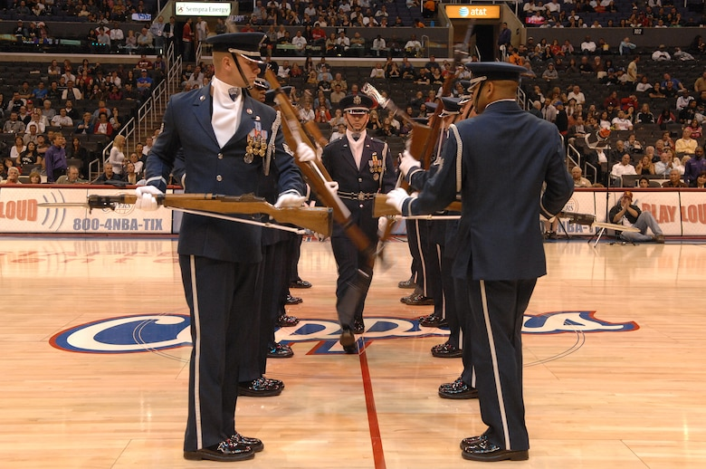 The U.S. Air Force Honor Guard Drill Team demonstrates precision rifle maneuvers at the Staples Center in Los Angeles before the Clippers vs. Spurs basketball game during Air Force Week, Nov. 17, 2008.  (U.S. Air Force photo by Senior Airman Matthew Smith)