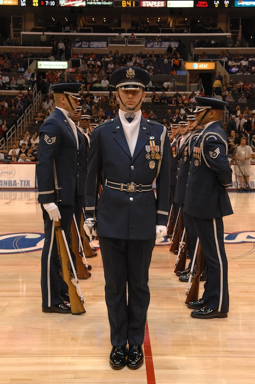 Captain Brent Mundie, a flight commander with the U.S. Air Force Honor Guard Drill Team from Bolling AFB, Washington D.C., performs at the Staples Center in Los Angeles California before the Clippers vs. Spurs basketball game during Air Force Week, Nov. 17, 2008.  (U.S. Air Force photo by Senior Airman Matthew Smith)