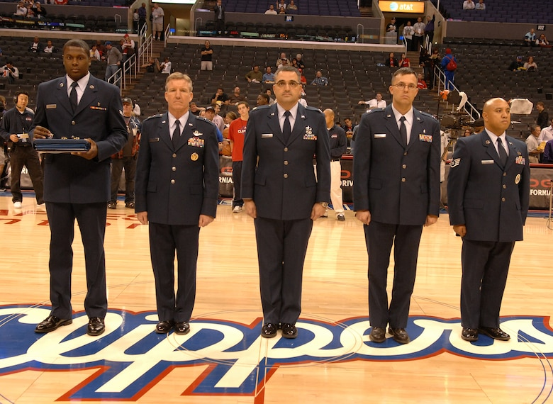 U.S. Air Force medal recipients stand center court at the Staples Center in Los Angeles Calif., before the LA Clippers take on the San Antonio Spurs, Nov. 17.  The Airmen were awarded their medals at the game in recognition of Air Force Week. (U.S. Air Force photo by Senior Airman Matthew Smith)