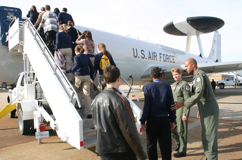 Col. Patricia Hoffman, commander, 552nd Air Control Wing, and Capt. Brian Hardeman, air battle manager, 552nd Operations Group welcome DelQuest students onto the E-3 Sentry for a tour and a chance to talk with several crewmembers. Photo compliments of 1Lt Kinder Blacke.
