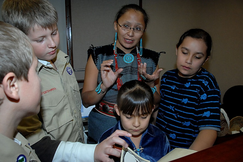 OFFUTT AIR FORCE BASE, Neb. -- Local boy scouts listen to Native American story telling at the library here Nov 15. Dia Molnar, a Navajo woman, answered questions for the boy scoouts and other attendees about the Navajo alphabet.  (U.S. Air Force Photo By Kendra Williams)