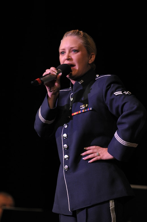 Airman First Class Pamela Kelly, vocalist with the Band of the Golden West, sings to a crowd at the Warner Grand Theater, Nov. 16. The concert is one of the various events through out Southern California during Air Force Week.   (Photo by Joe Juarez)