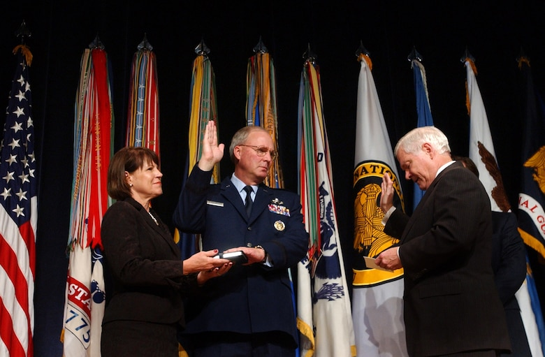 Gen. Craig R. McKinley is sworn in by Secretary of Defense Robert M. Gates as the 26th chief of the National Guard Bureau as his wife, Cheryl McKinley, holds a bible during a Nov. 17 ceremony at the Pentagon. General McKinley was also promoted to his current rank and is the first Guard officer to be promoted to the four-star rank. (U.S. Army photo/Staff Sgt. Jon Soucy)