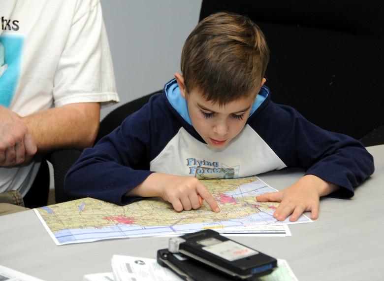 During the preflight briefing Hunter intently studies the map ensuring that he has no question of which way do I go?