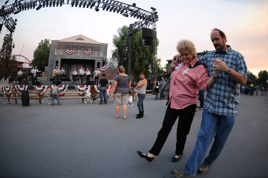 Cheri Greer and John Foote two-step as members of the Air National Guard Band of The Southwest perform at Knott's Berry Farm Nov. 15 in Los Angeles. The band is performing during Air Force Week Los Angeles, which is an event designed to educate the local population about the Air Force's capabilities and missions through various activities and exhibitions all over the Los Angeles area. (U.S. Air Force photo/Staff Sgt. Desiree N. Palacios)