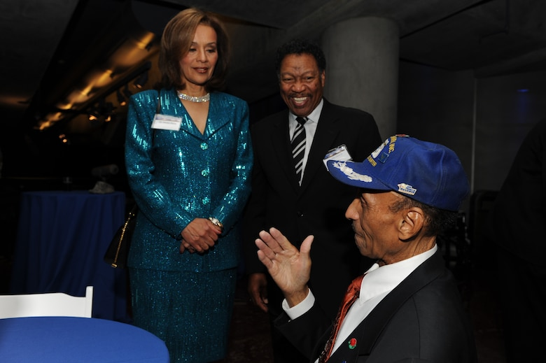 Marilyn McCoo and Billy Davis Jr. talk to O. Oliver Goodall Nov. 17 at the Griffith Park Observatory in Los Angeles. Mr. Goodall is a Tuskegee Airman who was honored by the Friends of the Observatory during Air Force Week Los Angeles. Ms. McCoo and Mr. Davis were former singers of the group, The Fifth Dimension. (U.S. Air Force photo/Staff Sgt. Desiree N. Palacios)