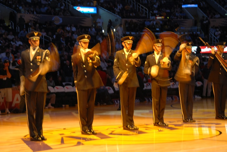Air Force Honor Guard Drill Team members demonstrate their precision moves prior to the start of the Lakers vs. Bulls game, Nov. 18. The Washington D.C. based team has been performing at various events in support of Air Force Week in Southern California, Nov. 14-21. (Photo by Joe Juarez)