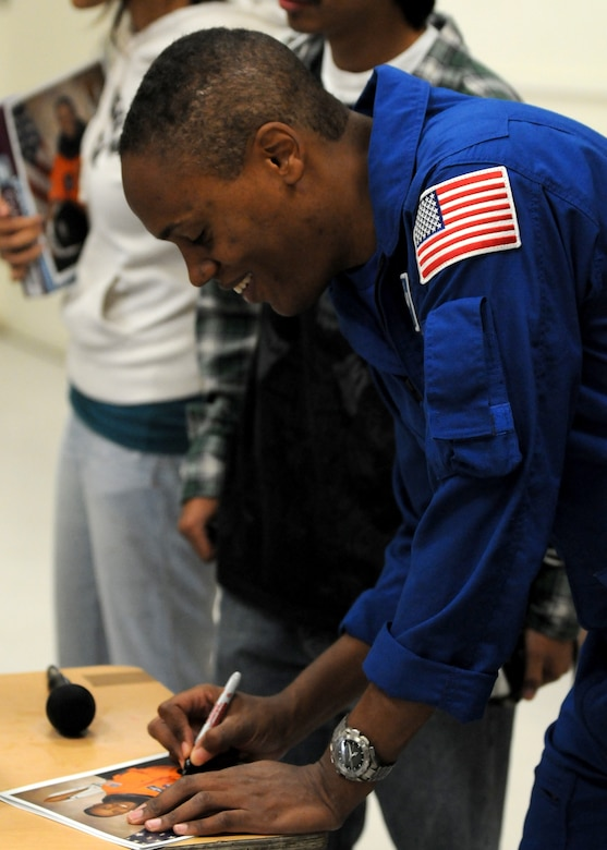 Air Force Astronaut Col. B Alvin Drew signs autographs for students at Westchester High School, Nov. 20. The colonel visited the school to talk to students about his space experiences. His visit was one of many events held during Air Force Week in Southern California. (U.S. Air Force photo by Stephen D. Schester)