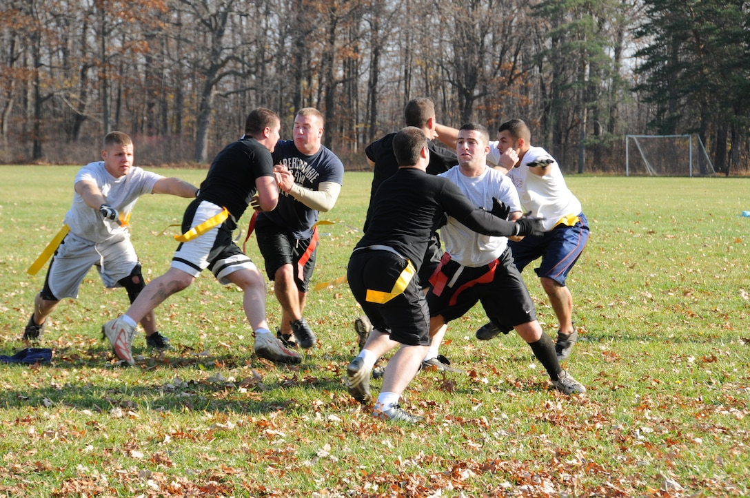 107th Airlift Wing, Security Force members hold their own against the U.S. Coast Guard, Cleveland Station, Ohio. Both teams came ready to play for a worthy cause. The first Toys for Tots Flag Football tournament was recently held at Fort Niagara State Park. U.S. Air Force photo/Senior Airman Peter Dean
