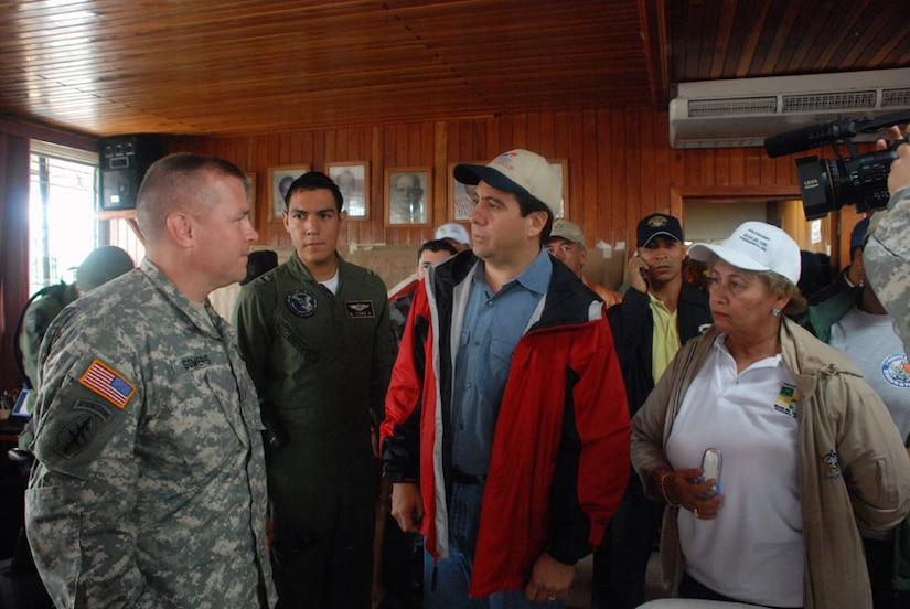 CHANGUINOLA, PANAMA-- President of Panama, Martin Torrijos, discusses planned rescue missions of flood victims cut off from food, water and medical attention, with Army Lt. Col. Richard Somers, disaster task force commander deployed here from Joint Task Force-Bravo Honduras. Eighteen service members from JTF-Bravo are here in support of a request from the Panamanian government for assistance with recent flooding caused by prolonged heavy rains in the country. (U.S. Air Force photo by 1st Lt. Candace Park)