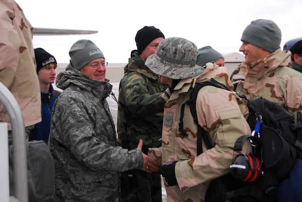 U.S. Air Force Col. Mark Johnson, Wing Commander, (left) shakes hands with guardsmen as approximately 125 members of the 148th Fighter Wing, Duluth Minn. load an aircraft and deploy to Joint Base Balad, Iraq on November 27, 2008 as a part of its Air Expeditionary Force (AEF) deployment. (U.S. Air Force photo by TSgt Jason W. Rolfe) (Released)