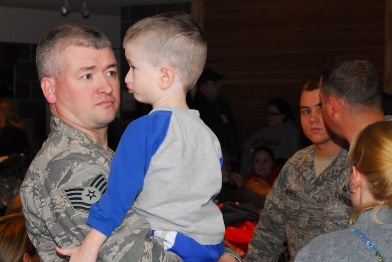 U.S. Air Force Tech. Sgt. Brad Johnson says goodbye to his son as he and approximately 125 members of the 148th Fighter Wing, Duluth Minn. deploy to Joint Base Balad, Iraq on November 27, 2008 as a part of its Air Expeditionary Force (AEF) deployment. (U.S. Air Force photo by TSgt Jason W. Rolfe) (Released)