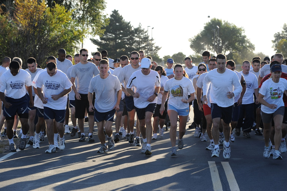 Team Buckley Members take off to start the Operation Warm Heart 5K run here Sept. 26. More than 70 people took part in the run to help raise donations for military families during the holidays. The Buckley First Sergeants Association, in conjunction with the 460th Space Wing Chapel, runs Operation Warm Heart. Donations are still being accepted. To make a donation, talk to a first sergeant any time of year. (Air Force photo by Airman 1st Class Christopher Bush.)