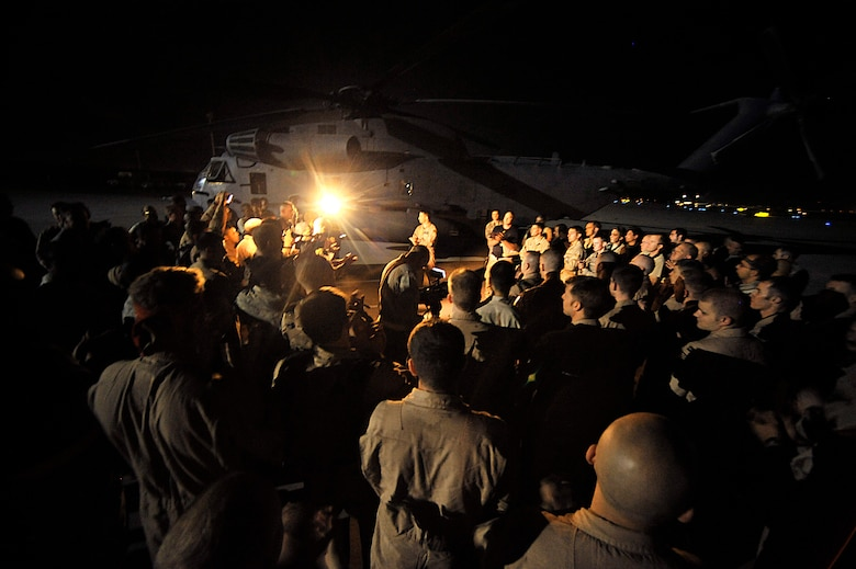 Lt. Col. Gene Becker speaks to the crews and maintainers after the last combat mission of the MH-53 Pave Low Sept. 28 in Iraq. The 20th ESOS MH-53 helicopters and their crews provided much of the vertical lift, direct action and logistical resupply to the Combined Joint Special Operations Task Force in Iraq. Colonel Becker is the 20th Expeditionary Special Operations Squadron commander. (U.S. Air Force photo/Staff Sgt. Aaron Allmon)