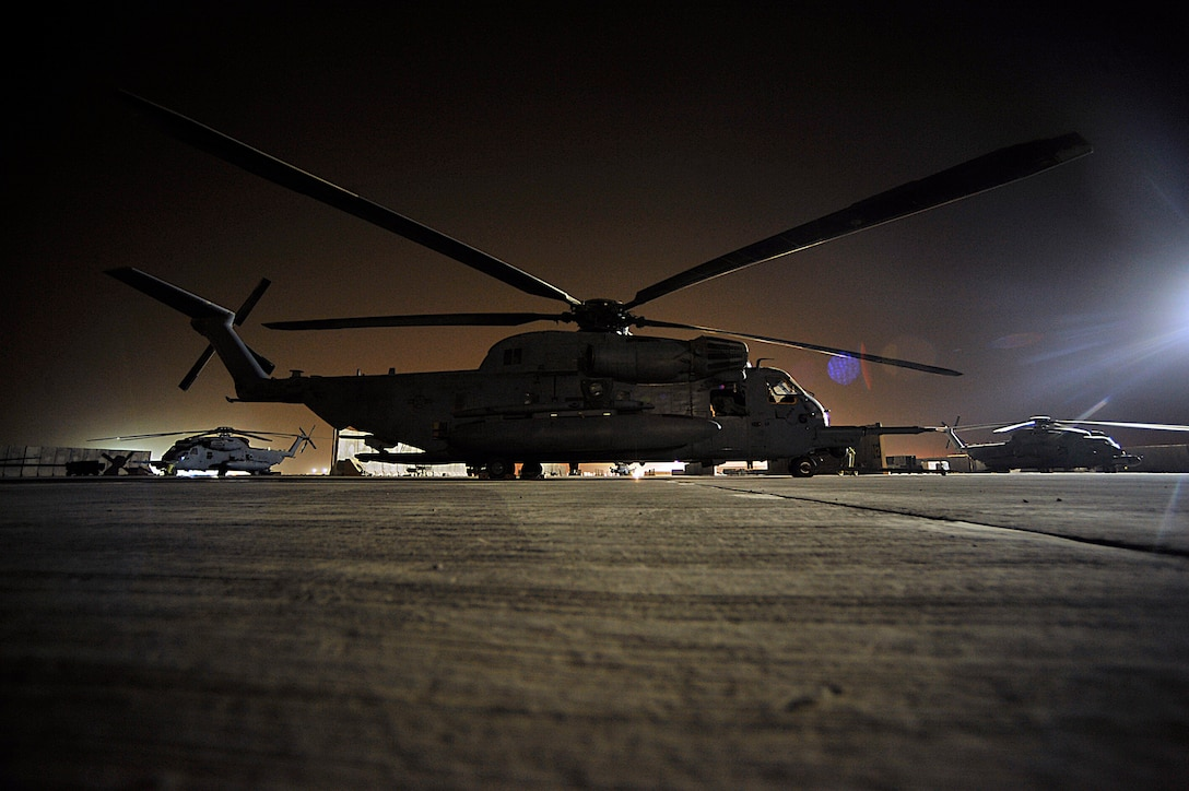 MH-53 Pave Lows from the 20th Expeditionary Special Operations Squadron sit on the tarmac prior to the last combat mission of the helicopters Sept. 27 in Iraq. The MH-53 is retiring after nearly 40 years of service to the Air Force. (U.S. Air Force photo/Staff Sgt. Aaron Allmon)