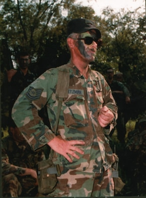 Former Tech. Sgt. Reynolds A. Kuntzman is all ready with warrior paint while working in the field as a member of the then-Air Mobility Warfare Center's 421st Ground Combat Readiness Squadron in 1995 on a Fort Dix, N.J., range.  Sergeant Kuntzman died on June 9, 1995.  After his death, the center's leadership created the Reynolds A. Kuntzman Duty Performance Award given annually to an Airman in the grades of E-1 through E-6 recognizing superior duty performance in support of the center's mission and community.  (Photo courtesy of the Kuntzman family)