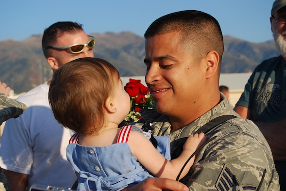 Staff Sgt. Ramon Escobedo greets a loved one Sep. 22 during the 729th Air Control Squadron's Hill AFB homecoming. In May, over 200 Airmen from the unit deployed to Joint Base Balad, Iraq to provide radar air surveillance and command and control of coalition aircraft for combatant commanders. During the four-month rotation, the 729th ACS' air battle managers and support personnel alongside its ground radar and tactical vehicle equipment controlled over 277,000 square miles of Iraq's airspace for over 3,000 hours. (Photo by 1st Lt. Beth Woodward)